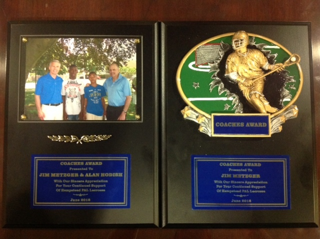 Hempstead PAL honors James C. Metzger for support of Youth Lacrosse program.